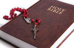 Holy Bible with rosary Stock Images