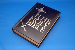 Holy Bible and rosary. On blue background Royalty Free Stock Images