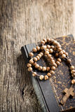 Holy bible and rosary beads Royalty Free Stock Images