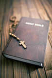 Holy bible with rosary beads Stock Photos