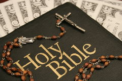 Holy Bible, Rosary & Money. Holy Bible, Rosary with $20 bills on table for tithing Stock Photography