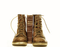 Holy bible and rugged boots. Retro vintage close up photo of Holy bible and rugged boots Stock Photography