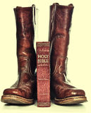 Holy bible and rugged cowboy boots Stock Photo