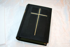 Holy bible on silk. Old bible book on white silk royalty free stock photography