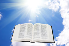Holy bible in the sky illuminated by a sunlight royalty free stock images