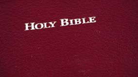 Holy Bible slowly moving over white background stock video footage