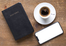 Holy Bible and smartphone with black coffee cup. On wooden background. Time for study concept stock photos
