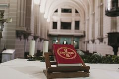 Holy bible on table during a wedding ceremony nuptial mass. Religion concept. Catholic eucharist ornaments for the celebration of. The Eucharist stock image