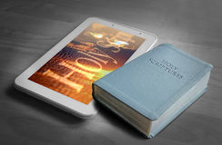 Holy bible tablet and book Stock Images