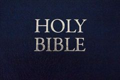 Holy Bible title closeup. Religion and faith concept. Religious literature. Bible isolated. Christianity background. Vintage Bible book royalty free stock photo