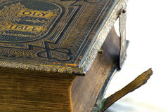 Holy Bible vintage side detail. The Holy Bible, a vintage edition, with clasps at the side to hold the covers closed Royalty Free Stock Image