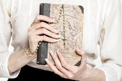 Holy Bible and white rosary Royalty Free Stock Photo