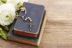 Holy Bible and white rosary. Stock Image