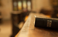 Holy Bible. On a wooden church bench Stock Photography