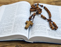 Holy Bible with wooden crucifix Stock Images
