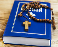 Holy Bible with wooden crucifix Stock Photo