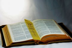 Holy Bible; Word of God with page marker. Vintage old Holy Bible page marker presented to represent enlightenment royalty free stock photos