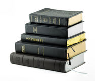 Holy Bibles. A pile of Holy Bibles isolated on a white background Stock Image