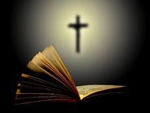 Holy book. Open book with cross background Royalty Free Stock Photo