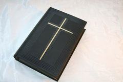Holy book. Very old bible book on white silk stock image