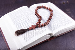 Holy book and cross on a wooden background Stock Photos