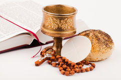 Holy bread. Holy book and holy bread on white stock photos