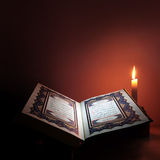 Holy book of Islam with candle light. Royalty Free Stock Photos