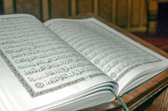Holy book Koran. Open holy book Koran inside a mosque stock images