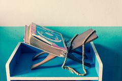 Holy book of Koran on stand. In pastel tone Royalty Free Stock Images