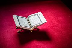 Holy book of Koran on stand on red carpet Royalty Free Stock Image