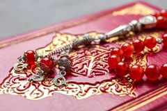 Holy book of Muslims and prayer beads. Closeup Stock Image