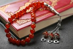 Holy book of Muslims and prayer beads. Closeup Stock Images