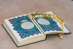 The holy book  Quran  and the rosary .  Arabic greeting written appeal prayer . Stock Photography
