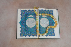 The holy book  Quran  and the rosary .  Arabic greeting written appeal prayer . Royalty Free Stock Images