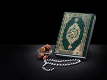 Holy Book of Quran With Rosary and Dates Stock Images