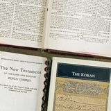 Holy books three faiths square. Showing Three faiths holy books the Christian bible and Koran and Hebrew jewish bibles on a table showing three of the many royalty free stock images