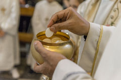 The Holy Bread during the Communion Royalty Free Stock Photo