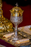 Holy chalice. On a tray used for wedding ceremonies and two biscuits stock image