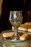 Holy chalice. On a tray used for wedding ceremonies and two biscuits royalty free stock photos