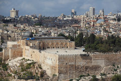 Holy City of Jerusalem.The Al-Aqsa Mosque. Holy City of Jerusalem. Black Dome of the Rock mosque - the Al-Aqsa Mosque. In the background - modern skyscrapers and Royalty Free Stock Image