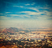 Holy city Pushkar. Rajasthan, India. Vintage retro hipster style travel image of Holy city Pushkar aerial view from Savitri temple with grunge texture overlaid Royalty Free Stock Photo