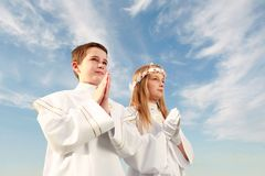 Holy communion. Boy and girl in first holy communion, purity conscience, praying hands Royalty Free Stock Photography