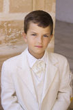 Holy communion. A young boy celebrating his first holy communion Royalty Free Stock Photo