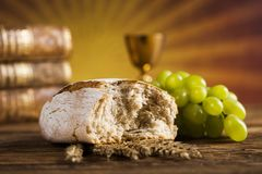 Symbol christianity religion a golden chalice with grapes and br. Holy Communion Bread, Wine for christianity religion stock photography