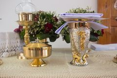 Holy communion chalice on wooden table stock image