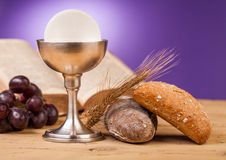 Holy communion. Chalice on wooden table royalty free stock photos