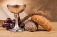 Holy communion composition. Holy communion chalice on wooden table Stock Photo