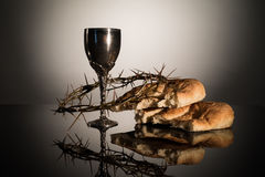 Holy Communion. Crown of Thorns, Wine goblet and bread Stock Photo
