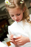 Holy communion gift. Young girl has received her first holy communion gift Royalty Free Stock Image