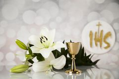 Holy communion a golden chalice with grapes and bread wafers. Eucharist, sacrament of communion background royalty free stock photography